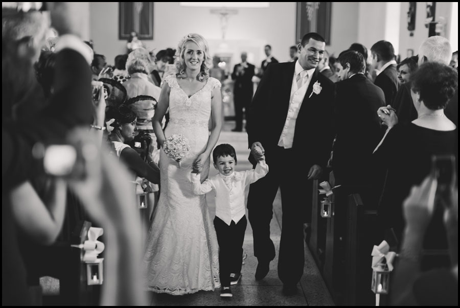 Their son gets in on every bride and groom photograph
