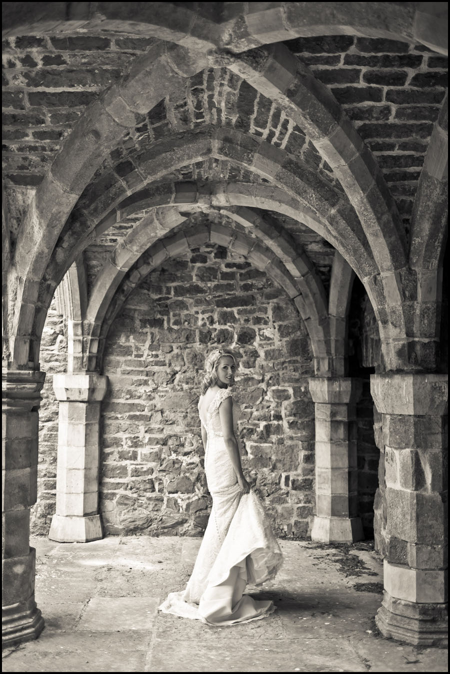Bride swishing her dress around at the Abbey