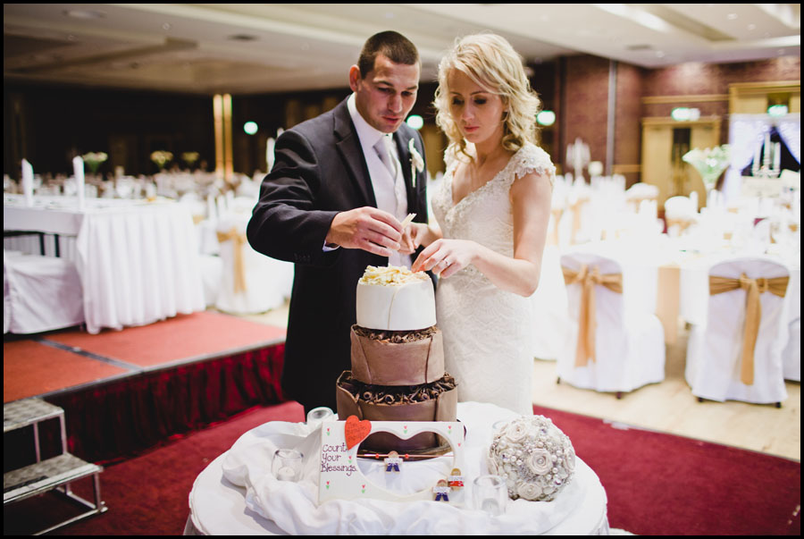 Bride and Groom Checking out the cake