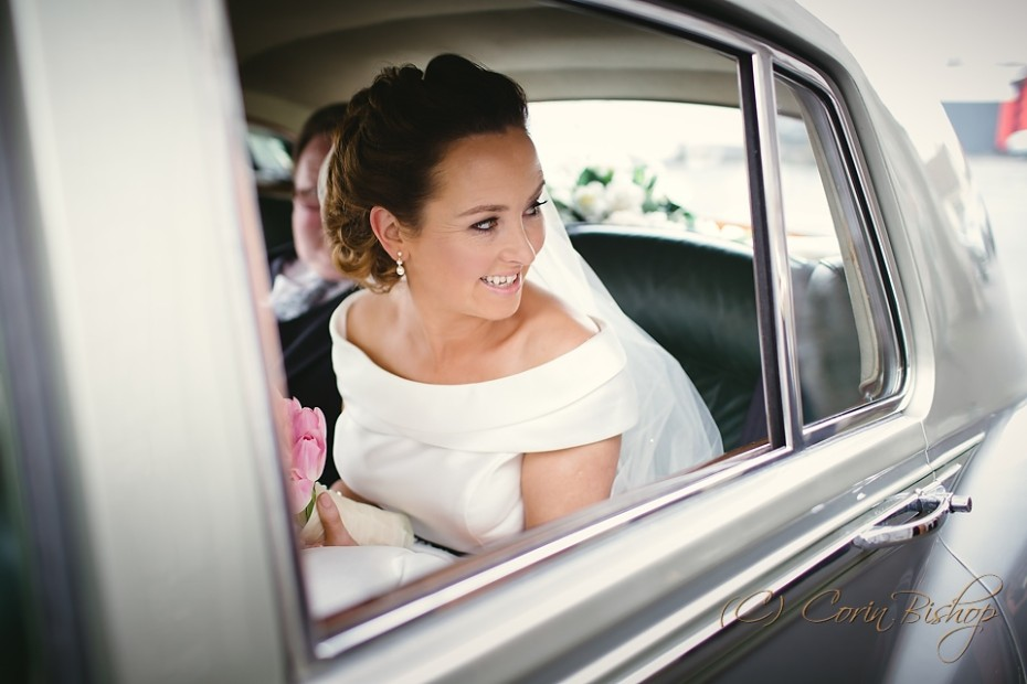 Bride in her Rolls Royce Wedding Car Looking Out