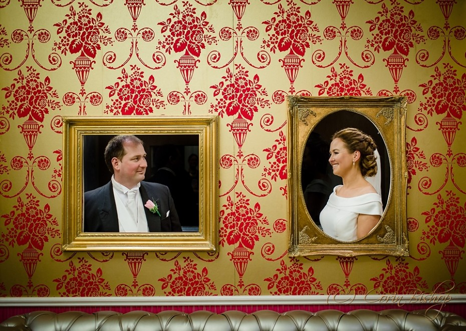 Bride and groom framed in portraits